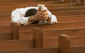 praying in pew